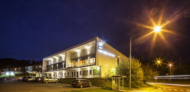 "Exterior of the hotel ""by night"""